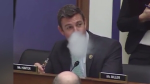 Rep. Duncan Hunter is seen using a vaporizer during a congressional hearing on Feb. 11, 2016, while arguing in favor of the use of the device on planes. (Credit: CNN)