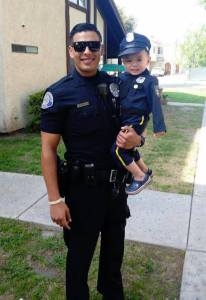 Tayden Nguyen, right, is seen with Westminster police Officer Mike Gradilla. (Credit: Westminster Police Department)