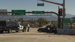 Police remained on scene hours after a pursuit ended in a fatal crash in San Bernardino on March 8, 2016. (Credit: KTLA)