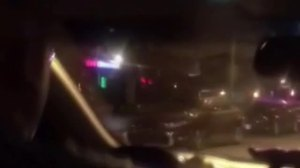 A LYFT driver was removed after video showed him driving with a the door open and a passenger asking him to stop. This image was provided by WJLA via CNN.