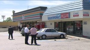 A 7-Eleven where two employees were stabbed during an attempted robbery was cordoned off with crime scene tape on March 25, 2016. (Credit: KTLA)