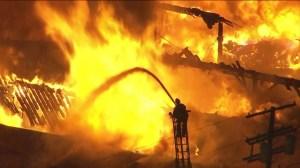 Firefighters battle an greater-alarm fire in Boyle Heights on March 10, 2016. (Credit: KTLA)