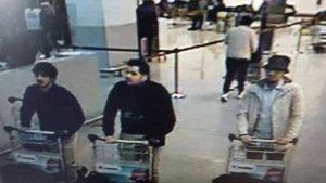 This picture released by Belgian police on March 22, 2016, shows suspects in the Brussels attacks. Two were thought to have committed suicide attacks, while the man in the light jacket and hat was being sought.