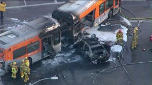 At least seven people were injured, two critically, in a fiery crash between a car and a bus in South Los Angeles on March 28, 2016. (Credit: KTLA)