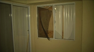 The man had tried to break-in to this window, which he apparently though led to his own bedroom, when he was fatally shot, his relatives said. (Credit: KTLA)