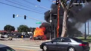 A witness's video shows an overturned pickup truck engulfed in flames after a six-vehicle crash in Torrance on March 12, 2016. (Credit: Scott)