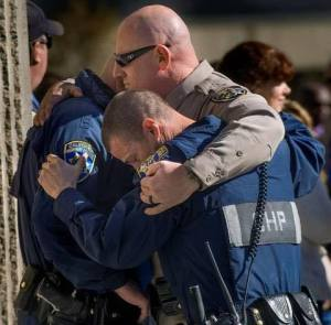 An image posted to Facebook by CHP's Truckee office shows the two officers - in blue - who responded to the crash that killed Officer Nathan Taylor. They embraced at a ceremony for Taylor on March 15, 2016.