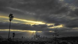 Sunlight streams out from behind clouds above downtown Los Angeles in this file photo. (Credit: Allen J. Schaben / Los Angeles Times)