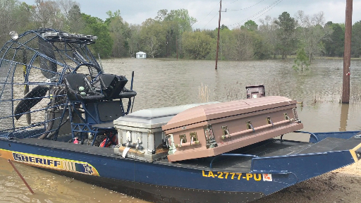 Officials were scrambling to recover several caskets that were seen floating away from a cemetery in Lake Charles, Louisiana. (Credit: Zeb Johnson and Charlie Hunter)