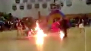 A still from a video taken by Twitter user @SolJah13 shows a fire-breather in flames at a performance in Delray Beach, Florida, on March 16, 2016.
