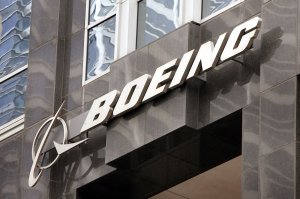 The Boeing logo hangs on the corporate world headquarters building of Boeing November 28, 2006 in Chicago, Illinois. (Credit: Scott Olson/Getty Images)