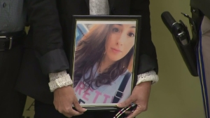 Gigi Littlefield holds a picture of her daughter Michelle at a news conference on March 23, 2016. (Credit: KTLA)