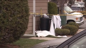 The area around a trash can was cordoned off after the discovery of a dead infant outside a Staten Island, New York, resident on March 12, 2016. (Credit: WPIX)