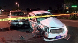 A wrong-way driver who was suspected of DUI crashed into six vehicles, including one with an Uber sticker, in Huntington Beach on March 17, 2016. (Credit: KTLA)