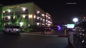 A man was shot by police Tuesday night at a Quality Inn hotel in Ontario. (Credit: Loudlabs)