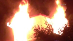 A two-story home caught fire in Calabasas on March 16, 2016. (Credit: OnScene.TV)
