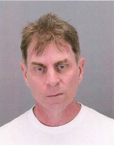 John MaGuire, 50, was arrested Saturday at the Detroit Metropolitan Airport after failing two sobriety tests, airport police said. (Credit: Wayne County Airport Authority)