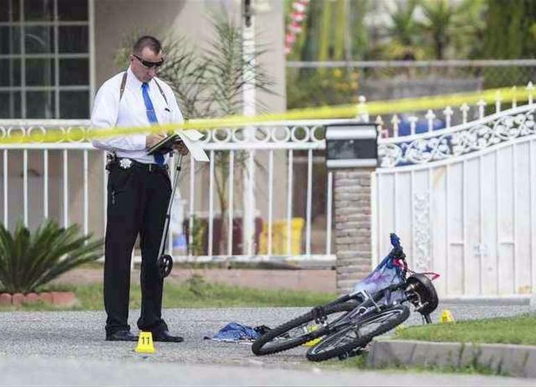 San Bernardino police detectives investigated a fatal shooting that left a bicyclist dead on March 3, 2016. (Credit: San Bernardino Sun)