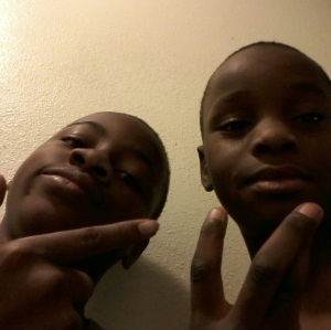 Jason Spears, right, was killed in the shooting, which injured Terrance Spears, left. The boys are seen in a photo provided to KTLA by family members.