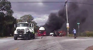 Dashcam video released by the Indian River County Sheriff's Office on March 23, 2016, shows two deputies rescuing a woman from a burning car in Florida.