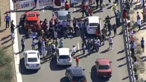 Dozens of protesters blocked traffic outside a Donald Trump event on March 19, 2016. (Credit: KNXV)