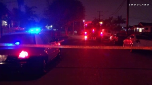 Police and firefighter-paramedics responded after an Uber driver was shot and killed in Inglewood on March 20, 2016. (Credit: Loudlabs)