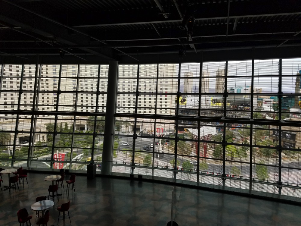 View from inside T-Mobile Arena looking through mesh video screen.
