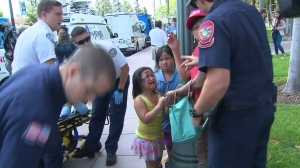 A little girl cries after five people are pepper-sprayed at a Trump-related rally in Anaheim on April 26, 2016. (Credit: KTLA)