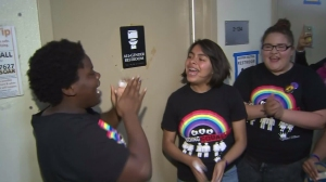 Students at Santee Education Complex welcome the installation of a gender-neutral bathroom on campus on April 14, 2016. (Credit: KTLA)