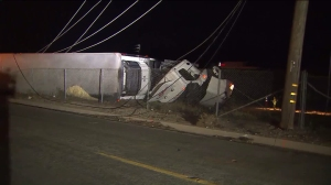 A big rig crashed in Castaic and got tangled in power lines on April 13, 2016. (Credit: KTLA)