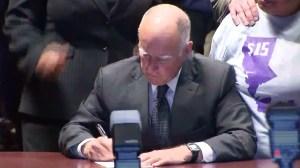 Gov. Jerry Brown signs California's new minimum wage law on April 4, 2016. (Credit: KTLA)