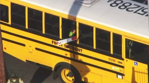 A child can be seen in a school bus that was impaled by a crossing arm on April 26, 2016. (Credit: KTLA)