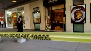 Police tape is seen outside a Ben Bridge store at the Santa Monica Place shopping mall on April 24, 2016. (Credit: KTLA)