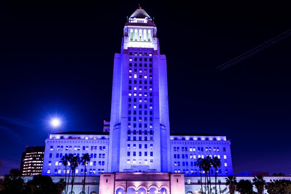 Los Angeles City Hall's exterior was bathed in purple light on April 21, 2016, after the death of musical icon Prince was announced. (Credit: @MayorOfLA/Twitter)