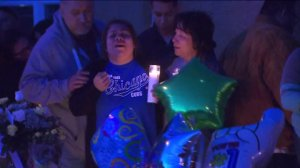 "Dominick Gallegos' grieving mother cries out ""Oh, my baby"" at a vigil for the 12-year-old boy outside the family's home in Colton on April 13, 2016. (Credit: KTLA)"