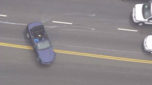 """A Ford Mustang led authorities on a pursuit that included """"donuts"""" in Hollywood on April 7, 2016. (Credit: KTLA)"""