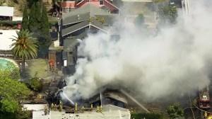 Los Angeles firefighters battle flames at multiple homes in Koreatown on April 29, 2016. (Credit: KTLA)
