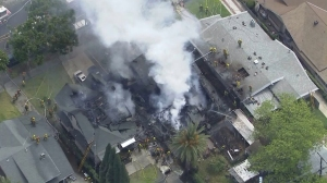 One home appeared completely gutted and at least two others seriously damaged in a fire in Koreatown on April 29, 2016. (Credit: KTLA)