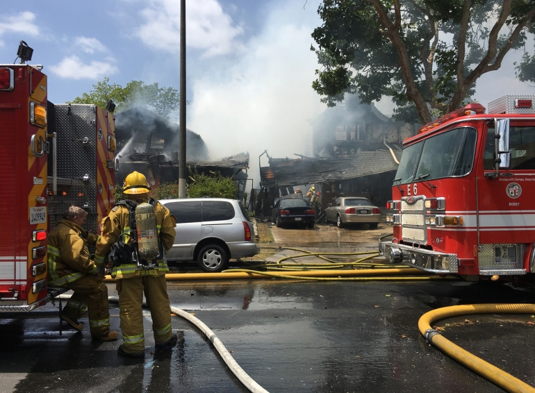 Firefighters remain on scene after a house fire in Koreatown is knocked down April 29, 2016. (Credit: John Moreno / KTLA)