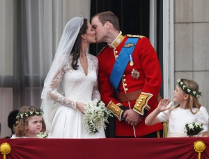Their Royal Highnesses Prince William, Duke of Cambridge and Catherine, Duchess of Cambridge kiss on the balcony at Buckingham Palace on April 29, 2011 in London, England (Credit: Peter Macdiarmid/Getty Images)