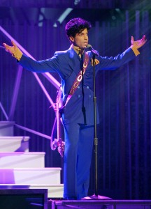 "Grammy and Oscar-winning recording artist Prince performs the song ""Purple Rain"" at the 46th Annual Grammy Awards held at the Staples Center on Feb. 8, 2004, in Los Angeles. (Credit: Frank Micelotta/Getty Images)"