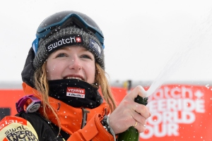 A picture taken on April 2, 2016 shows World champion Switzerland's Estelle Balet celebrating after she won the women's snowboard event during the Verbier Xtreme Freeride World Tour. (Credit: FABRICE COFFRINI/AFP/Getty Images)