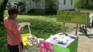 Nine-year-old Tristan is seen near his lemonade stand in Springfield, Missouri. (Credit: KYTV)