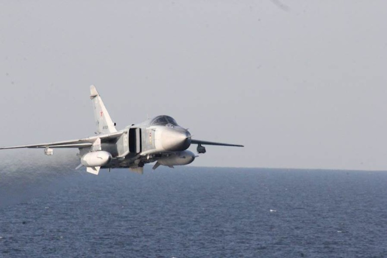 160412-N-ZZ999-005 A Russian Sukhoi Su-24 attack aircraft makes a very low-altitude pass by USS Donald Cook April 12, 2016, in this photo released by the U.S. Navy.