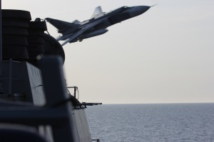 A Russian Sukhoi Su-24 attack aircraft makes a very low-altitude pass by USS Donald Cook April 12, 2016, in this photo released by the U.S. Navy.