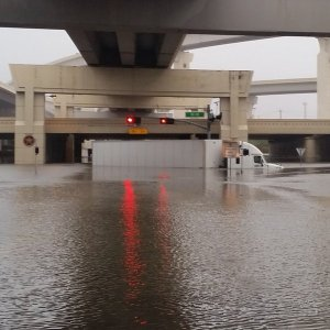 A big rig got struck on flooded road in Houston in this photo posted by Twitter user JR Cohen.