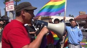 A speaker from Union del Barrio speaks at a rally outside Santee Educational Complex on April 20, 2016. (Credit: KTLA)