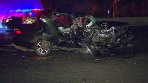 One person died and another was hospitalized after a three-vehicle crash on the 101 Freeway in Sherman Oaks on April 10, 2016. (Credit: KTLA)