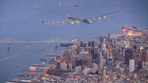 In this handout image supplied by Jean Revillard, Solar powered plane 'Solar Impulse 2', piloted by Swiss adventurer Bertrand Piccard, flies over the Golden Gate bridge in San Francisco, after a flight from Hawaii during its circumnavigation, before landing at Moffett Airfield in Mountain View in Silicon Valley, on April 23, 2016. (Credit: Jean Revillard via Getty Images)