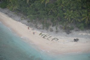 """A message for """"Help"""" was constructed by castaways trapped on a remote island. (Credit: U.S. Coast Guard)"""